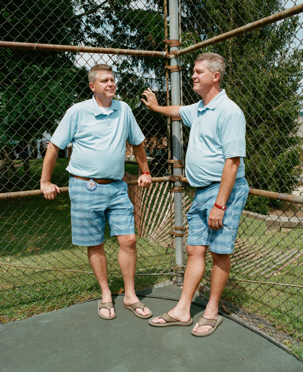 Chris and John, 51, government workers from Cincinnati and Pittsburgh who've attended Twins Days for 20 straight years, married their wives months apart. Their baby girls were born months apart, then their boys also. Chris is the more disciplined one.